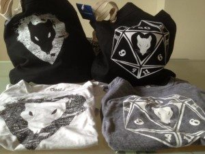 Ladies 'merch' includes shirts and bags.
